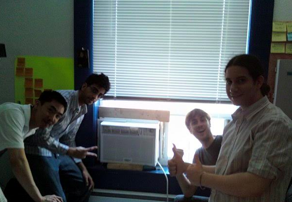 BNOTIONS team, celebrating the arrival of their first air conditioner.