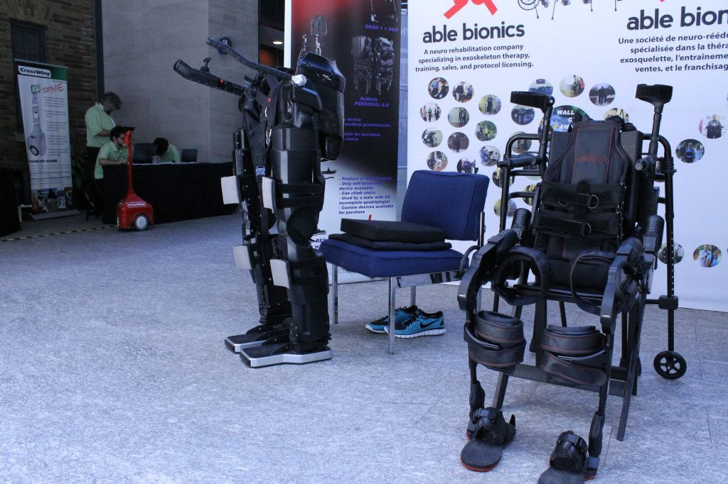 Able Bionics is a gait neurorehabilitation company operating in London, Ontario and Aspen, Colorado and specializing in exoskeleton therapy, training, sales, and protocol licensing. The Ekso Bionics exoskeleton is on the right and the Rex exoskeleton is on the left.
