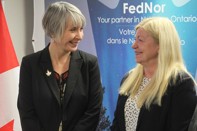 Thunder Bay-Superior North MP Patty Hajdu (left) talks with Northern Ontario Angels executive director Mary Long-Irwin at a media conference announcing FedNor funding on Thursday