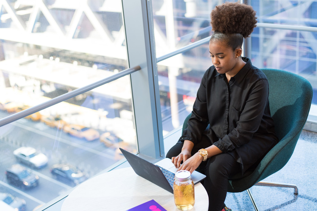 Black woman tech worker using computer
