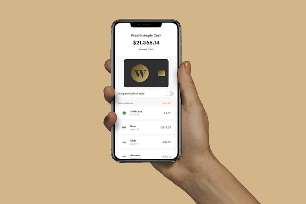 Hand holding phone with Wealthsimple Cash app open