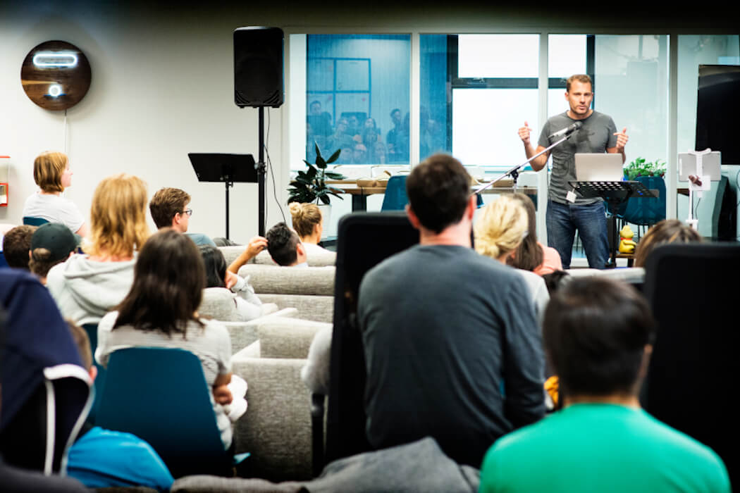 Greg Smith of Thinkific addressing team at Thinkific HQ