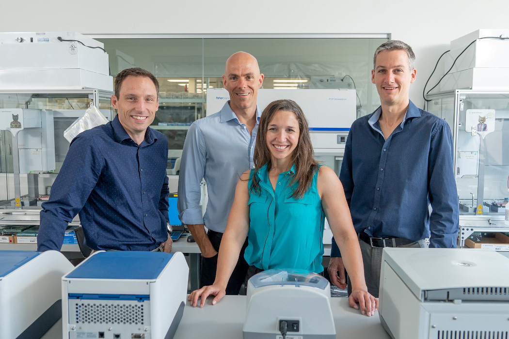 AbCellera's leadership team in a company lab