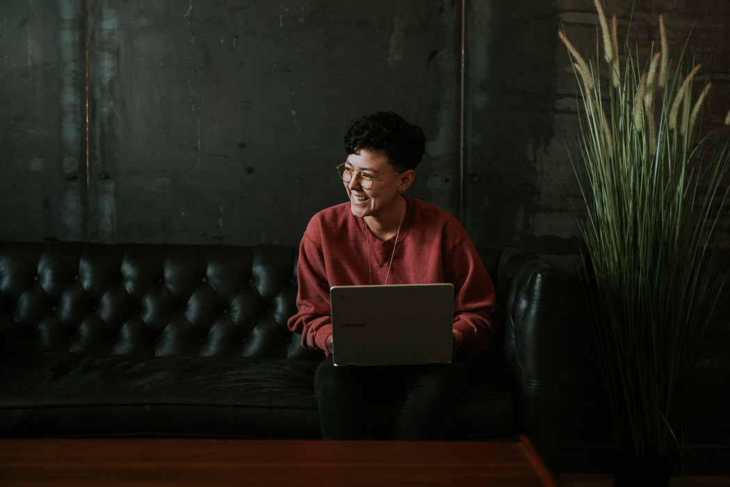 Smiling woman using a laptop