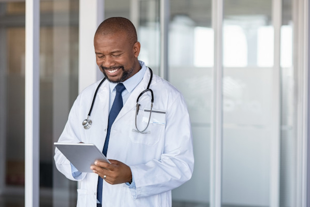 Smiling doctor using Think Research's tech