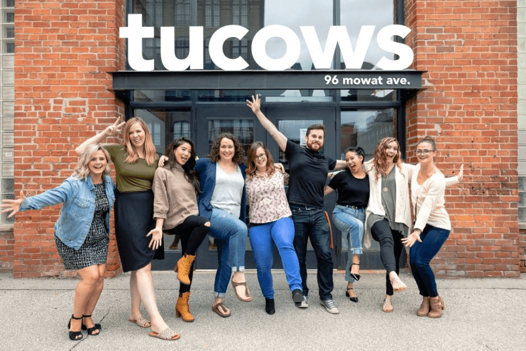Members of the Tucows team outside of their office