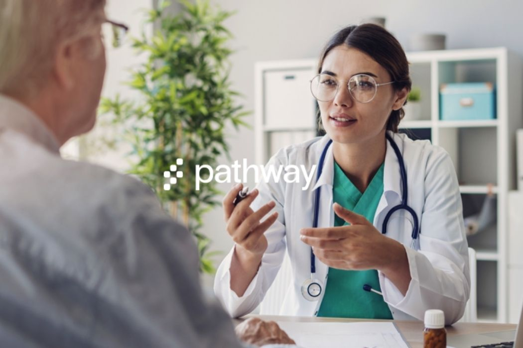 A doctor talking to a patient. The pathway logo is on top of the entire image.